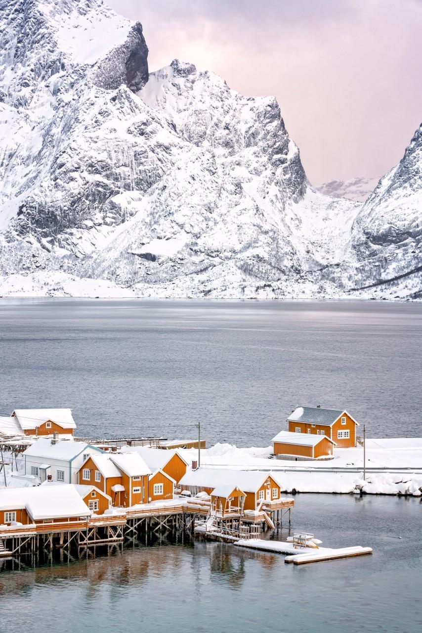 A village in Lofoten with orange houses in winter