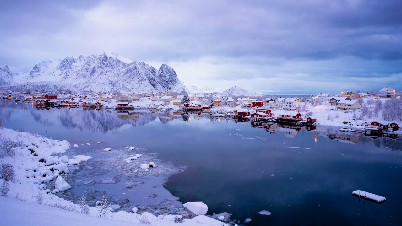 Wide shot of a village on the Lofoten in Norway with red houses