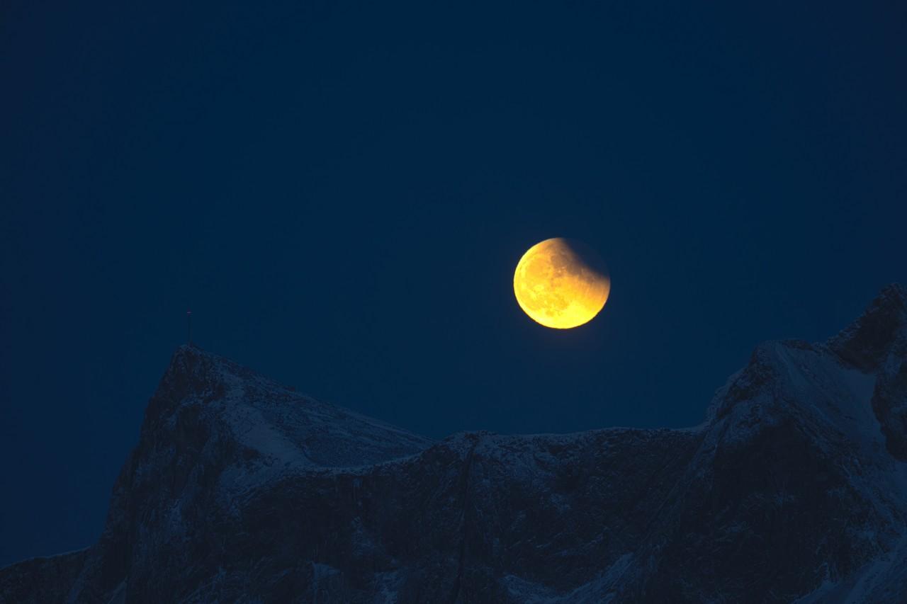 yellow orange moon on the Lofoten in Norway
